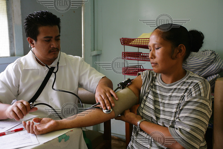 A doctor takes the blood pressure of a woman in the ante-natal clinic in Central Hospital in Apia. Samoa (formerly known as Western Samoa).
