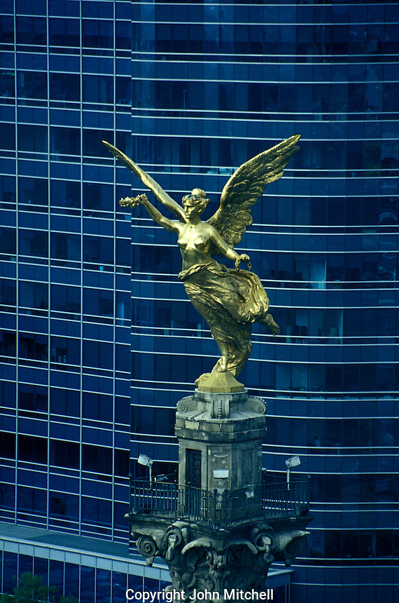 Close-up of the Victory statue on top of the Monumento a la Independencia or El Angel on Paseo de la Reforma in Mexico City. This 45 metre high monument was erected the centennial of 1910.