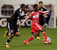 Patrick Nyarko (14) of the Chicago Fire sprints past Rodney Wallace (22) of DC United at RFK Stadium in Washington, DC.  The Chicago Fire defeated DC United, 2-0.
