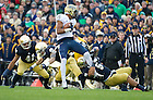 Nov. 3, 2012; Linebacker Manti Te'o stops Pittsburgh wide receiver Devin Street during the second quarter. Photo by Barbara Johnston/University of Notre Dame