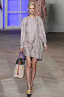 Patricia van der Vliet walks the runway in a purple/yellow glen plaid silk long-sleeved t-shirt dress, by Tommy Hilfiger for the Tommy Hilfiger Spring 2012 Pop Prep Collection, during Mercedes-Benz Fashion Week Spring 2012.