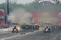 Sept. 1, 2012; Claremont, IN, USA: NHRA top fuel dragster driver Luigi Novelli (left) races alongside Ike Maier during qualifying for the US Nationals at Lucas Oil Raceway. Mandatory Credit: Mark J. Rebilas-