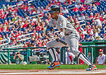 20 September 2015: Miami Marlins infielder Dee Gordon lays down a bunt during game action against the Washington Nationals at Nationals Park in Washington, DC. The Marlins fell to the Nationals 13-3 in the final game of their 4-game series. Mandatory Credit: Ed Wolfstein Photo *** RAW (NEF) Image File Available ***