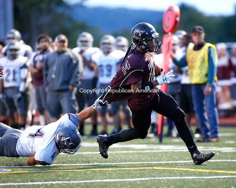Torrington, CT- 25 September 2015-092515CM14- Torrington's Newton Frias attempts to find the end zone as Naugatuck's Brandon Papp  tries make a tackle during their NVL matchup in Torrington on Friday.      Christopher Massa Republican-American