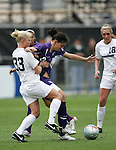 2 December 2005: PSU's Zoe Bouchelle (33) grabs the jersey of Portland's Christine Sinclair. The University of Portland Pilots defeated the Penn State Nittany Lions 4-3 on penalty kicks after the teams played to a 0-0 overtime tie in their NCAA Division I Women's College Cup semifinal at Aggie Soccer Stadium in College Station, TX.