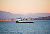 The Washington State Ferry Cathlamet runs it course in Puget Sound with the Cascades Mountain Range in the Background.