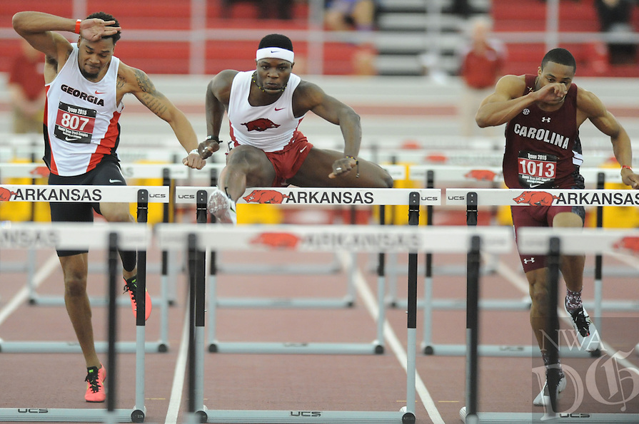 NWA Democrat-Gazette/ANDY SHUPE - Omar McLeod (center) of Arkansas pulls away from Devon Williams of Georgia (left) and Isaiah Moore of South Carolina as he competes in the 60-meter hurdles during the Tyson Invitational Friday, Feb. 13, 2015, at the Randal Tyson Track Center in Fayetteville.