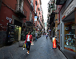 A shopper makes her way through Spaccanapoli in Naples.