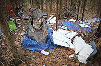 NWA Democrat-Gazette/DAVID GOTTSCHALK - 1/30/15 - A large amount of debris and trash outside a tent in the woods south of Martin Luther King Jr. Boulevard in Fayetteville Friday January 30, 2015 in the predawn hours. Areas with a homeless population were visited during the  Northwest Arkansas' biennial, 24-hour homeless census.