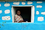 Cebonet Alcide in the window of her store, located in her home in Despagne, an isolated village in southern Haiti where the Lutheran World Federation has been working with residents to improve their quality of life.
