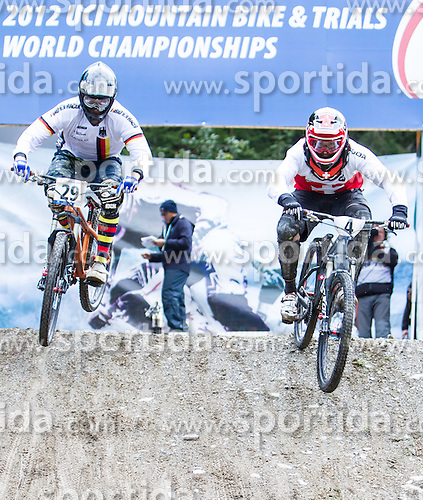 01.09.2012, Bikepark, Leogang, AUT, UCI, Mountainbike und Trial Weltmeisterschaften, MEN Elite, 4-Cross, im Bild Klaus Beige (GER) und Weltmeister Roger Rinderknecht (SUI) // Klaus Beige (GER) and Worldchampion Roger Rinderknecht (SUI) during UCI Mountainbike and Trial World Championships, MEN Elite, 4-Cross at the Bikepark, Leogang, Austria on .2012/09/01. EXPA Pictures © 2012, PhotoCredit: EXPA/ Juergen Feichter