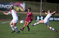Ines Jaurena (2) of Florida State passes the ball through Maisie McCune (13) and Alex Reed (7) of Maryland during the game at Ludwing Field in College Park, MD.  Florida State defeated Maryland, 1-0.