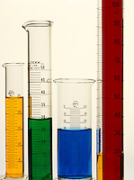 LABGLASS: GRADUATES W/ TRANSITION METAL SOLUTIONS<br /> Array of graduated cylinders<br /> NiCl2, Cu2SO4