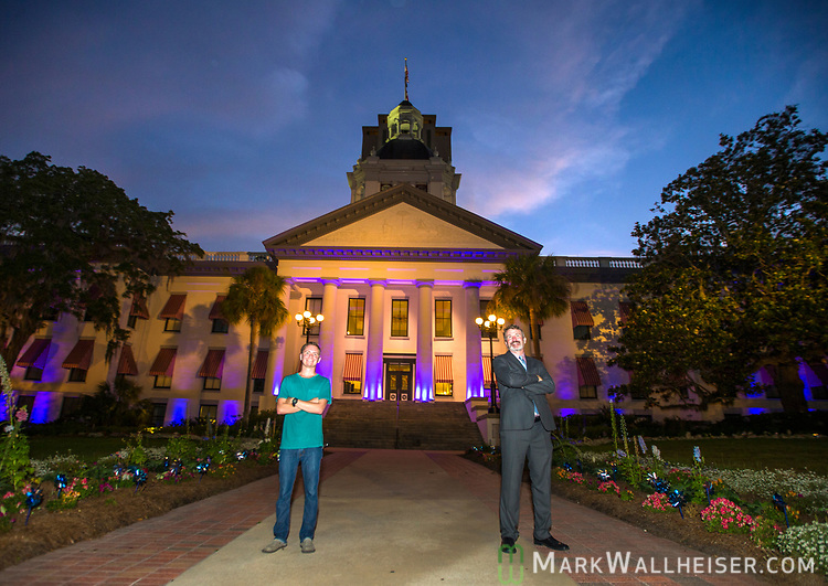 Two victims of cystic fibrosis, Taylor Chesney, left, of Tallahassee and Brian Callanan, founder and executive director of the Cystic Fibrosis Lifestyle Foundation, from Miami, both pose for photos during the Light Up CF event by the Cystic Fibrosis Lifestyle Foundation at the Florida Capitol in Tallahassee, Florida.