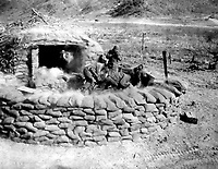 Men of the 4.2 mortar crew, 31st Heavy Mortar Co. fire at enemy position, west of Chorwon, Korea.  February 7, 1953.  Sgt. Guy A. Kassal. (Army)<br /> NARA FILE #:  111-SC-415620<br /> WAR &amp; CONFLICT BOOK #:  1436
