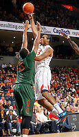 CHARLOTTESVILLE, VA- JANUARY 7: Mike Scott #23 of the Virginia Cavaliers shoots over Kenny Kadji #35 of the Miami Hurricanes during the game on January 7, 2012 at the John Paul Jones Arena in Charlottesville, Virginia. Virginia defeated Miami 52-51. (Photo by Andrew Shurtleff/Getty Images) *** Local Caption *** Mike Scott;Kenny Kadji