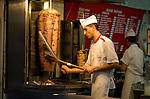 Take away vendor carving Doner in Taksim district if Istanbul, Turkey