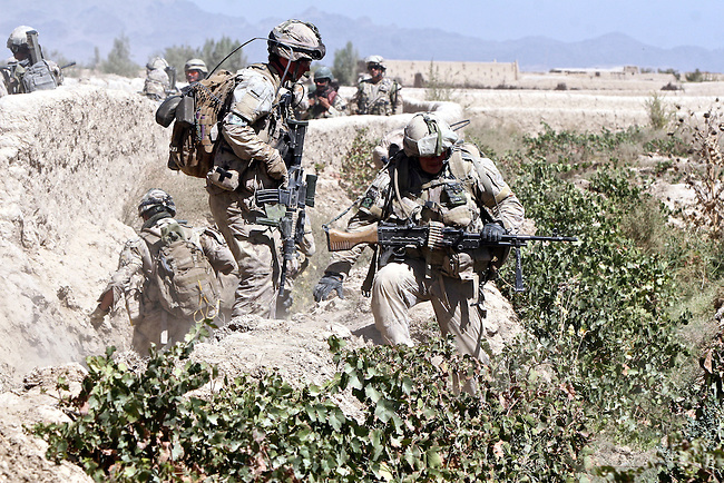 Canadian soldiers from November Company, 3rd Battalion, Royal Canadian Regiment maneuver through a grape orchard laced with deep trenches and thick mud walls during a patrol outside the village of Nakhonay, southwest of Kandahar, Afghanistan. Oct. 9, 2008. DREW BROWN/STARS AND STRIPES