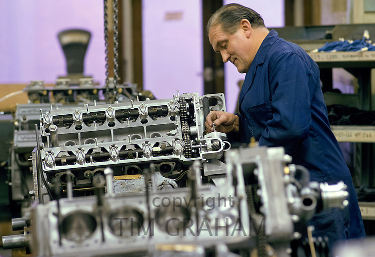 Production line worker building a car engine at the Aston Martin factory in Newport Pagnell, Buckinghamshire
