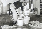 A resident switches out buckets from a leak in her roof as Hurricane Elena churned in the Gulf of Mexico off the coast of the Florida panhandle in September 2, 1985.  Elena was the first major hurricane of the 1985 season and it's unusual path included a loop and went back and fourth along the Florida panhandle as a category 3 storm heavily damaging the Apalachicola, FL oyster industry.  Apalachicola recorded the highest surge and rainfall totals and whatever oyster industry wasn't ruined by Elena was finished off when Hurricane Kate followed  in November of the same season.