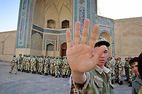 Bukhara, Uzbekistan, 16/05/2004..Uzbek soldiers march thorugh the centre of the ancient city of Bukhara to the Poi-Kalyan Complex which inlcudes the Kalyan Mosque and Mini Arab Madrassah.