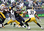 Seattle Seahawks running back Thomas Rawls (34) runs though the Pittsburgh Steelers at CenturyLink Field in Seattle, Washington on November 29, 2015.  The Seahawks beat the Steelers 39-30.      ©2015. Jim Bryant Photo. All Rights Reserved.
