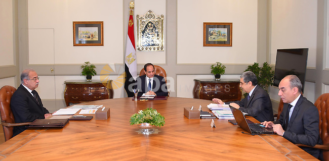 Egyptian President Abdel Fattah al-Sisi chairs a meeting with Prime Minister Sherif Ismail and Minister of Electricity and Renewable Energy Mohammed Shaker, in Cairo, Egypt, on April 11, 2017. Photo by Egyptian President Office