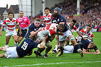 Michael Leitch of Japan attempts to reach the try-line. Rugby World Cup Pool B match between Scotland and Japan on September 23, 2015 at Kingsholm Stadium in Gloucester, England. Photo by: Patrick Khachfe / Onside Images