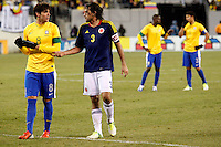 Colombian player Mario Yepes (3) speaks with Brazilian player Kaka after a fault call during their friendly match at MetLife Stadium in East Rutherford New Jersey, November 14, 2012. Photo by Eduardo Munoz Alvarez / VIEWpress.