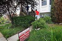 Would-be buyers get a tour around foreclosed houses in Woodbridge, Virginia. The area is suffering from a major collapse in the housing market following the subprime crisis and global credit crunch, which has forced the foreclosure and abandonment of numerous properties...