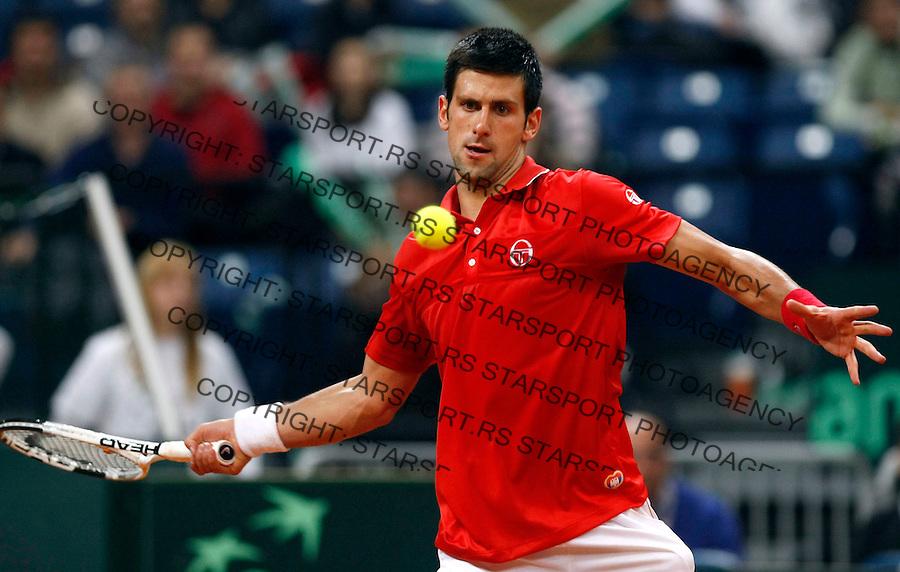 Tenis, Davis Cup 2010.Serbia Vs. USA.Novak Djokovic (SRB) Vs. Sam Querrey (USA).Novak Djokovic returnes.Belgrade, 05.03.2010..foto: Srdjan Stevanovic/Starsportphoto ©