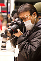 February 9, 2012, Yokohama, Japan - A visitor tries out the Canon EOS-1D X camera at the CP+ Camera and Photo Imaging Show 2012. The event is held from February 9-12. (Photo by Christopher Jue/AFLO)