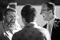 Groom Todd laughs with his friend Ken during his wedding ceremony and reception at Golden Gardens Bath House in Seattle.(Photo by Dan DeLong/Red Box Pictures)
