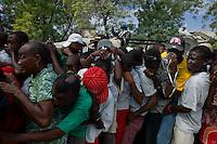Port Au Prince, Haiti, Jan 26 2010.A WFP food distribution near the 'Champ de Mars'; security and crowd control is the responsability of a Brazilian blue helmet UN unit..