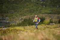 Runner passing Selfjord, Lofoten Ultra Marathon, 2016