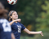 Yale University defender Ana Keusch (21) heads the ball. In overtime, Harvard University defeated Yale University,1-0, at Soldiers Field Soccer Stadium, on September 29, 2012.