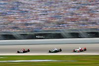 11 September, 2005, Joliet,IL,USA<br /> Dan Wheldon leads Tony Kanaan and Sam Hornish,Jr. along the main straight.<br /> Copyright&copy;F.Peirce Williams 2005