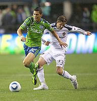 L.A. Galaxy midfielder David Beckham fouls Seattle Sounders FC forward Miguel Montañoduring play at Qwest Field in Seattle Tuesday March 15, 2011. The Galaxy won the game 1-0.