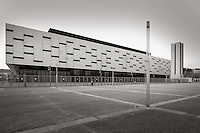 The Palasport Olimpico or Olympic Arena or Palaisozaki (from the name of the architect) is a multipurpose indoor sports/concert arena located at the Santa Rita district in Turin, Italy. The design of the building has been the subject of an international competition , won by a team led by architect Arata Isozaki of Tokyo. The futuristic building looks like a strict rectangular Cartesian coated stainless steel and glass, with a base of 183 to 100 meters. Spread over four levels, two underground ( up to 7.5 meters below ground) and two outdoor (up to 12 meters high ) . The overall length of the plant is about 200 meters..The structure, designed to be a veritable factory of events, using the words of its architect, is completely flexible and adaptable in its internal structure : the arrangement of furniture stands (thanks to a modern system of movable and retractable bleachers and the possibility of temporary movement of a deck), and plant in acoustics ..A kind of magic box, actually designed for an almost infinite potential use postolimpica : ice, various indoor sports, athletics, indoor concerts, shows, conventions, exhibitions, events, parades, shows, religious gatherings, etc..Its maximum capacity is 18,500 seats in concert mode...Taken on a cold hazy morning of April.