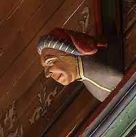 Carved and painted roof bracket with man in traditional headdress, architectural detail of the painted wooden ceiling in the shape of a boat's hull, in the Salle des Povres or Room of the Poor, almost 50m long, in Les Hospices de Beaune, or Hotel-Dieu de Beaune, a charitable almshouse and hospital for the poor, built 1443-57 by Flemish architect Jacques Wiscrer, and founded by Nicolas Rolin, chancellor of Burgundy, and his wife Guigone de Salins, in Beaune, Cote d'Or, Burgundy, France. The hospital was run by the nuns of the order of Les Soeurs Hospitalieres de Beaune, and remained a hospital until the 1970s. The building now houses the Musee de l'Histoire de la Medecine, or Museum of the History of Medicine, and is listed as a historic monument. Picture by Manuel Cohen