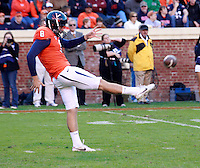 CHARLOTTESVILLE, VA- NOVEMBER 12: Punter Jimmy Howell #8 of the Virginia Cavaliers punts the ball during the game against the Duke Blue Devils on November 12, 2011 at Scott Stadium in Charlottesville, Virginia. Virginia defeated Duke 31-21. (Photo by Andrew Shurtleff/Getty Images) *** Local Caption *** Jimmy Howell