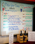 A white board announces the schedule of events at Philip Carter Winery.