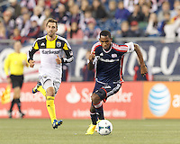 New England Revolution forward Jerry Bengtson (27) on the attack.  In a Major League Soccer (MLS) match, the New England Revolution (blue) defeated Columbus Crew (white), 3-2, at Gillette Stadium on October 19, 2013.