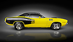 Yellow 1972 Dodge Challenger retro muscle car side view isolated on black background with clipping path