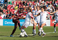 COLLEGE PARK, MD - OCTOBER 21, 2012:  Maisie McCune (13) of the University of Maryland blocks a shot by Tiffany McCarty (14) of Florida State during an ACC women's match at Ludwig Field in College Park, MD. on October 21. Florida won 1-0.