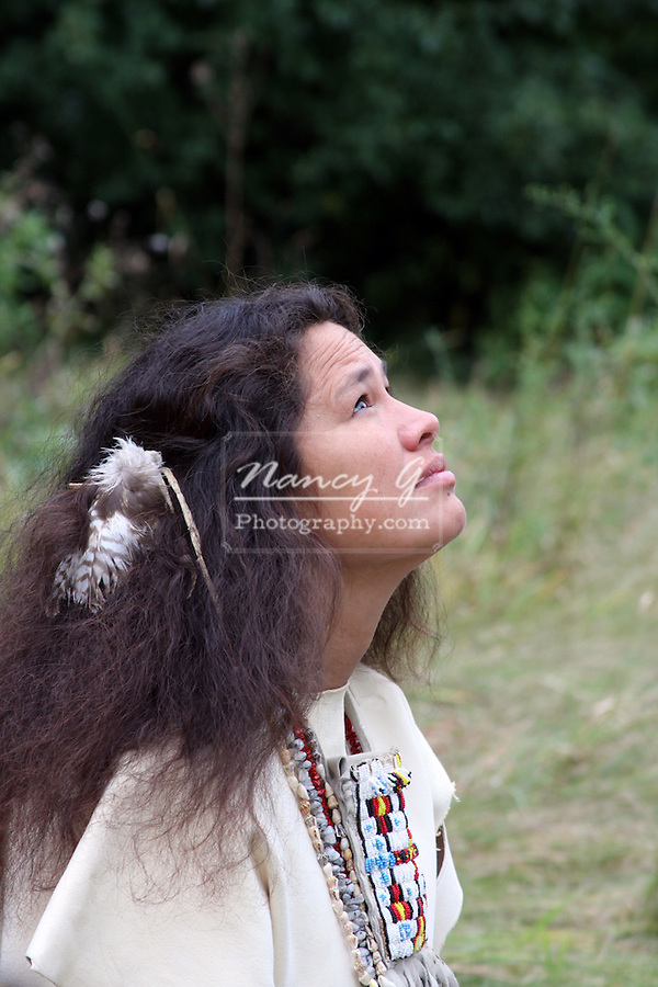 A Native American Lakota Sioux Indian woman looking up at the sky
