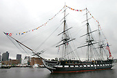 "Boston, MA - June 10, 2006 - USS Constitution, ""Old Ironsides"" gets underway for a turn-around cruise in Boston Harbor.  The world's oldest commissioned warship will cruise to Fort Independence on Castle Island where it will fire a 21-gun salute before returning to its berth at the Charlestown Navy Yard. The turn-around cruise is one of the high points of Boston Navy Week. Twenty-four such weeks are planned this year in cities throughout the United States, arranged by the Navy Office of Community Outreach (NAVCO). NAVCO is tasked with enhancing the Navy's brand image in areas with limited exposure to the Navy. .Credit: Dave Kaylor - U.S. Navy via CNP"