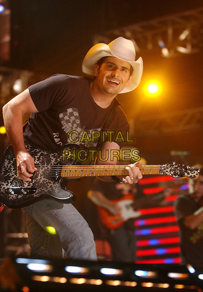 BRAD PAISLEY.2007 CMA Music Festival held at LP Field,Nashville, Tennessee, USA, 10  June 2007..half length country concert performing live on stage guitar hat.CAP/ADM/LF.©Laura Farr/AdMedia/Capital Pictures.
