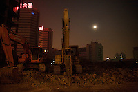 Construction equipment stands in a demolition site in central Urumqi, Xinjiang, China.