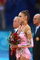 August 23, 2008; Beijing, China; Rhythmic gymnast Evgenia Kanaeva of Russia watches Russian flag raise and anthem play upon winning gold in the Individual All-Around final at 2008 Beijing Olympics..(©) Copyright 2008 Tom Theobald